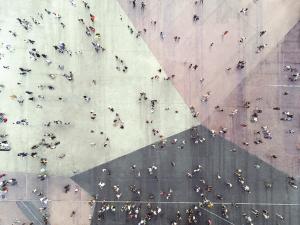 Aerial shot of people walking through city