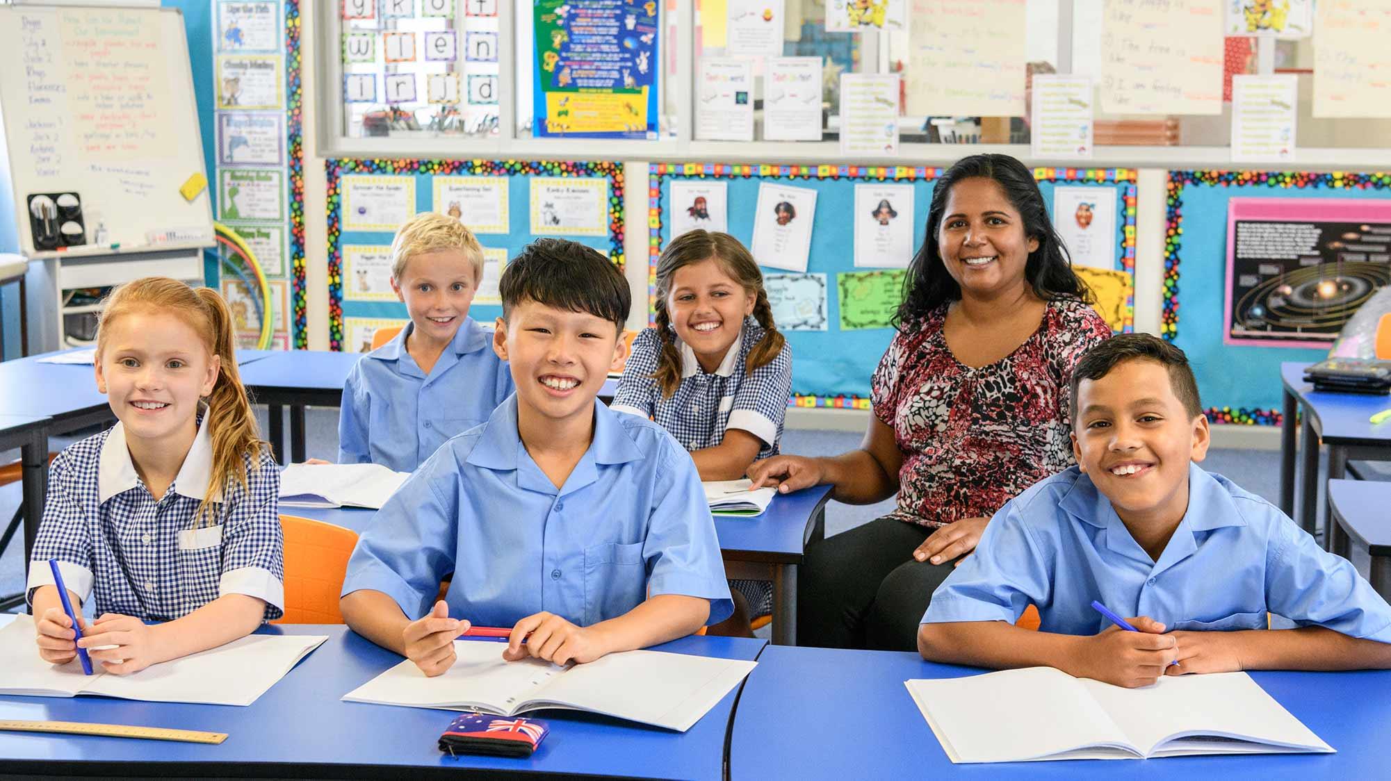 Teacher with five children in classroom